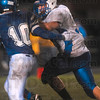 Tribune-Star/Joseph C. Garza<br /> Big run for 36: Rockville's Tophel Secuskie IV tries to keep North Vermillion's Jacob Harrison at bay as he runs for the endzone after he caught a pass during the Rox' sectional win Friday at North Vermillion.
