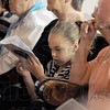 Reading: A young girl reads the acknowledgement on the back of the Obituary book handed out during the memorial service for Bettie Davis at the Allen Chapel Saturday afternoon.