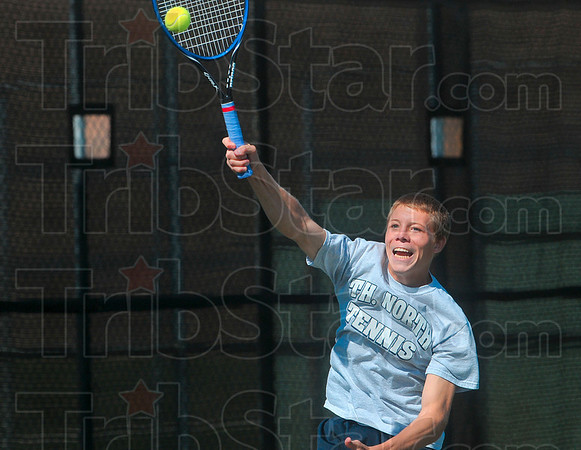 Tribune-Star/Joseph C. Garza<br /> On the attack: Terre Haute North's Jonathan Ray volleys a high return as he and teammate Alex Farmer close in to the net during the No. 2 doubles regional championship match against North Posey Saturday at Vincennes Lincoln.