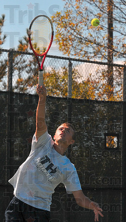 Tribune-Star/Joseph C. Garza<br /> Terre Haute North's Parker Fulkerson serves to a North Posey opponent during his and teammate Chris Holcomb's No. 1 doubles regional championship match Saturday at Vincennes Lincoln High School.