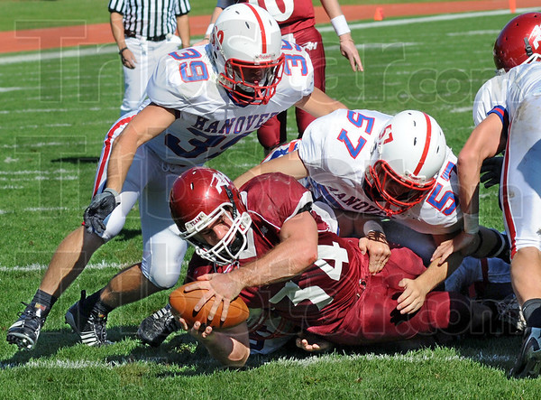 Score: Rose-Hulman's #34, Taylor Thornton reaches across the goal line to score during the second quarter to put Rose ahead Hanover in their annual meeting.