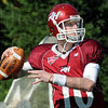 Lookin' long: Rose-Hulman quarterback Derek Eitel looks downfield during game action against Hanover Saturday afternoon at Cook Stadium.