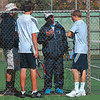 Tribune-Star/Joseph C. Garza<br /> Courtside discussion: Terre Haute North tennis coach Jim Cook instructs the No. 2 doubles team of Alex Farmer and Jonathan Ray as assistant coach Bob Denny listens in during their regional championship match against North Posey Saturday at Vincennes Lincoln.