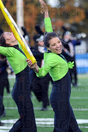 Havin' fun: A Terre Haute North performer puts on a happy face during Saturday's competition.