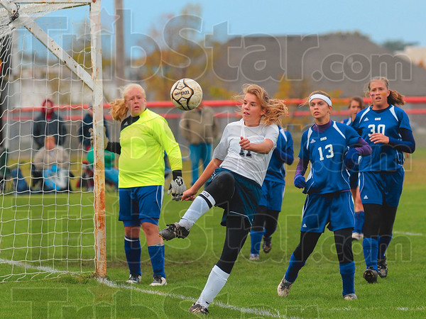 Tribune-Star/Joseph C. Garza<br /> Keep it in play: Terre Haute North's Madeline Whitaker tries to keep the ball in bounds as Sullivan's goal keeper Cobie Harrison and teammates Kelsey Burr and Kylee Wills look on Saturday at South.