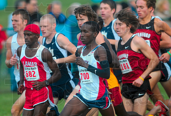 Tribune-Star/Joseph C. Garza<br /> Early leaders: Lamar's Francis Kasagule and Liberty's Samuel Chelanga jockey for the lead with hundreds of competitors at their heels during the men's White Race of the 2009 ISU Pre-National Invitational Saturday at the Lavern Gibson Championship Cross Country Course.
