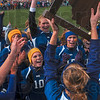 Tribune-Star/Joseph C. Garza<br /> Trophy toters: Sullivan's Caitlin Hauger hoists the girls sectional soccer trophy to the applause of her teammates after the Golden Arrows defeated Terre Haute North 2-1 Saturday at Terre Haute South.