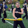 Drill: A North band member twirls a rifle during Saturday's competition at Memorial Stadium.