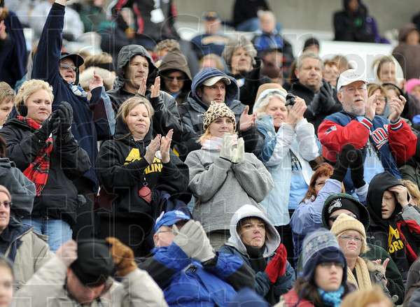Band a hand: The crowd responds to the Terre Haute North performance Saturday afternoon at Memorial Stadium.