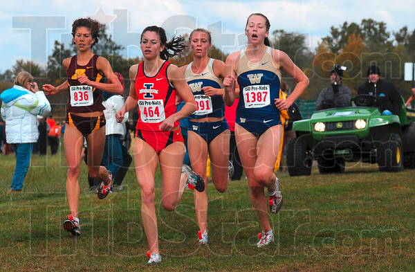 Tribune-Star/Joseph C. Garza<br /> A gopher, 2 huskies and a gator on her tail: Illinois' Angela Bizzarri leads competitors Megan Duwell of Minnesota and Washington's Katie Follett and Christine Babcock as they chase after Follett's and Babcock's teammate, Kendra Schaaf, who was in the lead during the women's 6,000-meter White Race of the 2009 ISU Pre-National Invitational Saturday at the Lavern Gibson Championship Cross Country Course.