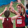 Tribune-Star/Joseph C. Garza<br /> High-five finish: Stanford's Chris Derrick high-fives teammate Elliott Heath after they finished first and third respectively in the 2009 ISU Pre-National Invitational Saturday at the Lavern Gibson Championship Cross Country Course.