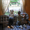 Window on the World: Two-year-old Azabelle Monson and her four-year-old brother Garin peer out the front room window of their Collett Park area home Friday afternoon.