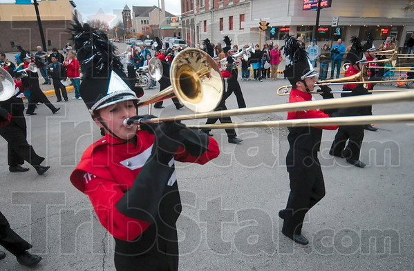 Tribune-Star/Joseph C. Garza<br /> Parade their Pride: Terre Haute South student Ethan Patterson marches around the corner of Fifth Street and Wabash Avenue as he performs with his fellow Pride of South members Saturday in the Indiana State University homecoming parade.