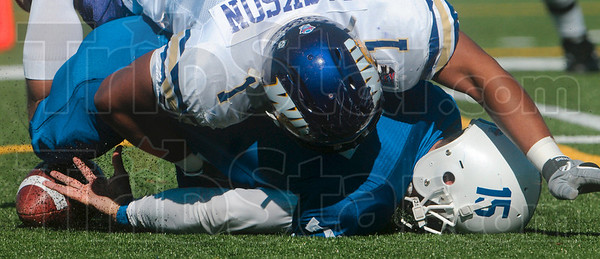 Tribune-Star/Joseph C. Garza<br /> He took his lumps: Indiana State quarterback Ryan Roberts is sacked by Western Illinois defensive lineman Cameron Jackson during the Sycamores' 17-14 win Saturday at Memorial Stadium.