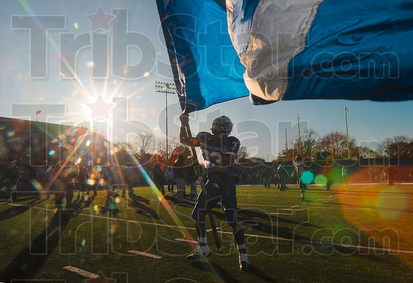 Tribune-Star/Joseph C. Garza<br /> Wave your victory flag: Indiana State running back Antoine Brown waves a giant ISU flag after the Sycamores' 17-14 win Saturday over Western Illinois at Memorial Stadium.