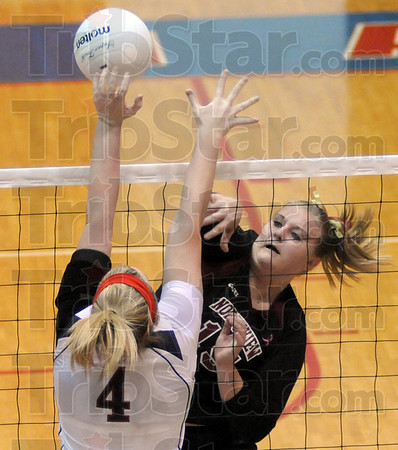 Blocked: North's #4, Mary Kate Etling gets her hand on a spike by Northview's #15, Samantha Solomon during game action Saturday night at Martinsville.
