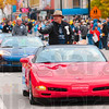 Tribune-Star/Joseph C. Garza<br /> Candy Corvette: Indiana State University Trustee Ron Carpenter tosses candy from a Corvette during the Indiana State homecoming parade Saturday on Wabash Avenue.