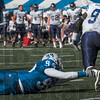 Tribune-Star/Joseph C. Garza<br /> Even if by a shoe lace: Indiana State's Aaron Archie reaches for the foot Western Illinois running back Dre Gibbs during the Sycamores' 17-14 win Saturday at Memorial Stadium.