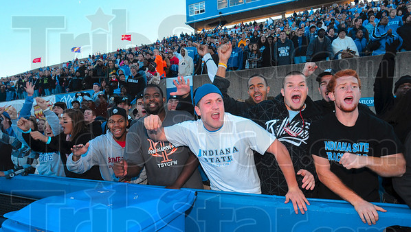 Tribune-Star/Joseph C. Garza<br /> This is it: Indiana State University football fans line a wall next to the field as the final seconds tick off the clock in the Sycamores' 17-14 win Saturday at Memorial Stadium.