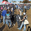 "Tent city: Thousands of Indiana State University students and alumni gather in the ""tent city"" at the east end of Memorial Stadium Saturday afternoon."