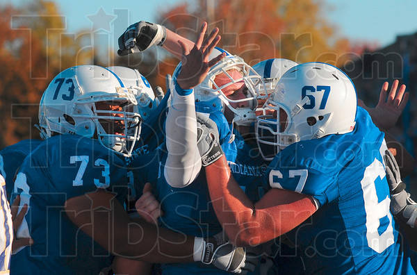 Tribune-Star/Joseph C. Garza<br /> The streak is over: Indiana State quarterback Ryan Roberts, center, is mobbed by his teammates after he scored the game-winning touchdown against Western Illinois Saturday at Memorial Stadium.
