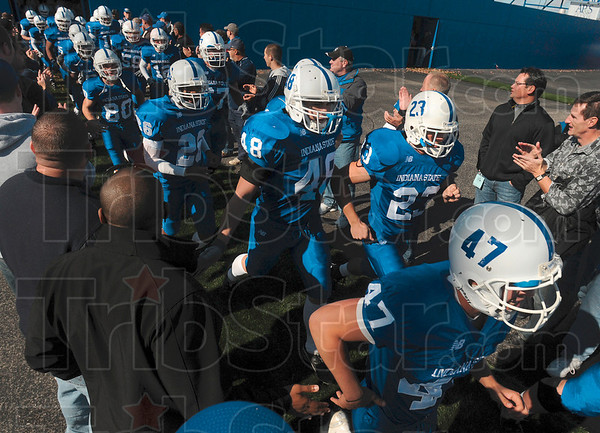 Tribune-Star/Joseph C. Garza<br /> Alumni support: The Indiana State football team is greeted by former football players as they enter the field Saturday before the team's homecoming game against Western Illinois at Memorial Stadium.