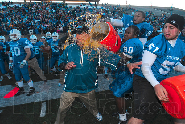 Tribune-Star/Joseph C. Garza<br /> To the victors, Gatorade!: Indiana State head football coach Trent Miles is drenched with the contents of a Gatorade container in the final seconds of the Sycamores' 17-14 win Saturday at Memorial Stadium.