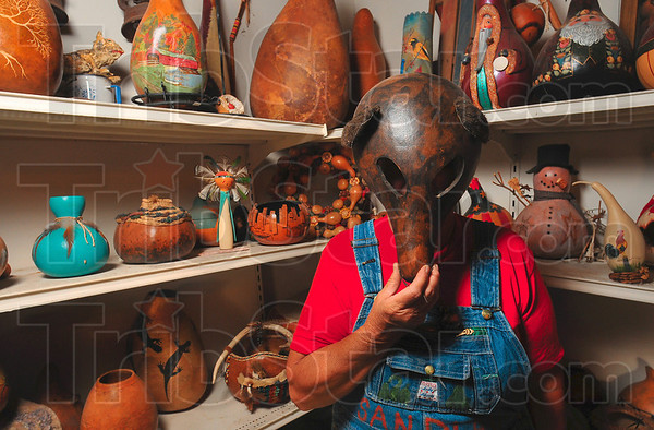 Tribune-Star/Joseph C. Garza<br /> Guess who: If already have your gourd bowl, gourd musical instrument or vase-shaped gourd flower holder, try a mask like Helen Thomas' bear mask which is just in time for Halloween.