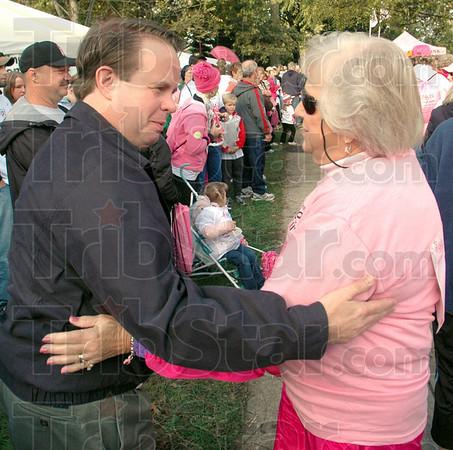 "Survivor: Cancer survivor Monica Hawkins (L) embraces Terre Haute oncologist Dr. Thomas Schmitz during the ""survivors walk"" at St. Mary's Saturday morning."