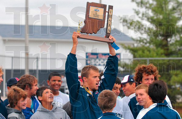 Tribune-Star/Joseph C. Garza<br /> To the victors go...a plaque!: Terre Haute North's Parker Fulkerson hoists up the sectional championship trophy after the Patriots defeated South to take the title Saturday at North.