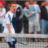 Tribune-Star/Joseph C. Garza<br /> Hard fought point: Terre Haute North's Tate Egan reacts after he won a point during his No. 3 singles sectional championship match against Terre Haute South's Torey Fox Saturday at North.