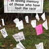 Sign detail: Names of those who lost the race against cancer line the sidewalk at St. Mary's Saturday morning.