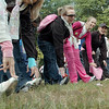 S-t-r-e-t-c-h: Race participants stretch to warm-up prior to Saturday's Race for the Cure at St. Mary's.