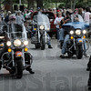 """Escort: A group of motorcyclists escorts the participants of the """"fun walk"""" through and around the St. Mary's campus Saturday morning."""