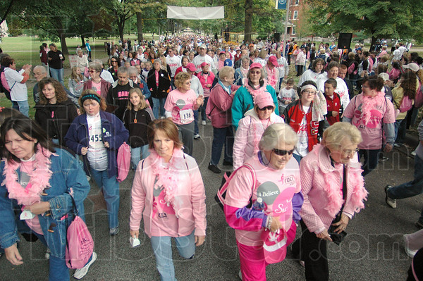 "Pretty in pink: Hundreds of participants take part in the ""fun walk"" prior to the 5K run at St. Mary's Saturday morning."