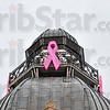 Tribune-Star/Joseph C. Garza<br /> Illuminating awareness: Pink ribbons adorn the dome of the Vigo County Courthouse in recognition of Breast Cancer Awareness Month Thursday.