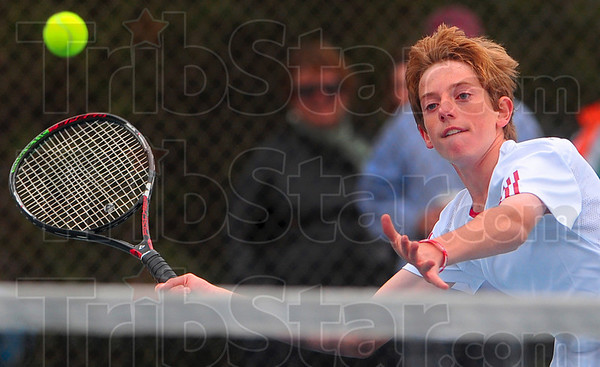 Tribune-Star/Joseph C. Garza<br /> Net play: Terre Haute South's Torey Fox closes in on a volley at the net from North opponent Tate Egan during their No. 3 sectional championship singles match Saturday at North.
