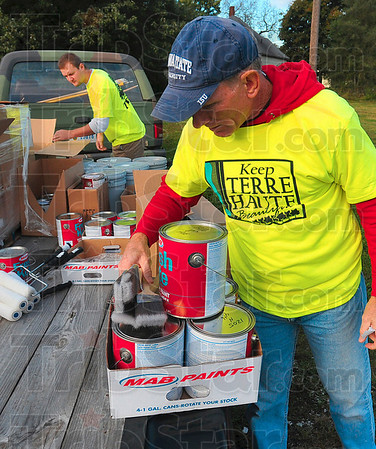 Tribune-Star/Joseph C. Garza<br /> Graffiti busters: Terre Haute Police Department Sgt. David Smith and Jared Morrison, manager of the Sherwin Williams south store, prepare supplies for graffiti clean up Saturday in the Bethlehem Temple Church parking lot.
