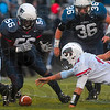 Tribune-Star/Joseph C. Garza<br /> Grab that!: Terre Haute North's A.J. Grady, Doug Collett and Nicholas Andreasen prepare to pounce on the ball after Lawrence North quarterback Will Nolden fumbled the ball in the first quarter of action Friday at North.