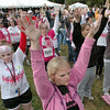 Warm-up: Race participants do a warm-up routine prior to the Race for the Cure Saturday morning at St. Mary's.