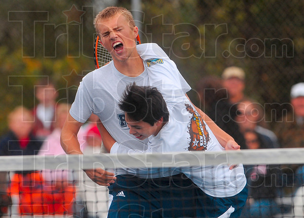 Tribune-Star/Joseph C. Garza<br /> Decisive match: Terre Haute North No. 1 doubles teammates Parker Fulkerson and Chris Holcomb celebrate their sectional championship match win over Terre Haute South Saturday at North.