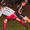 Tribune-Star/Joseph C. Garza<br /> Physical football: Terre Haute South's Kollin Monahan and Washington's Briar Goodwin collide as they try to reel in a loose ball during the Braves' 2-0 regional loss Wednesday at North.