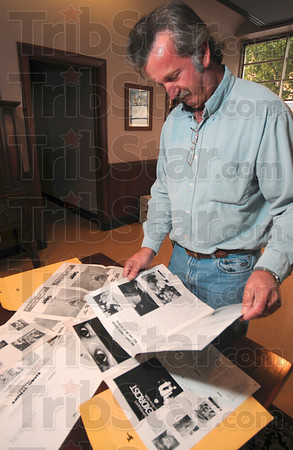 Tribune-Star/Joseph C. Garza<br /> Movie material: Indiana Theater owner Roger Aleshire looks through some of the promotional material for some of the theater's upcoming Midnight Movie Madness features including Animal House, Jaws and the Exorcist Wednesday in his office.