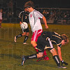 Tribune-Star/Joseph C. Garza<br /> How quickly the control changes: Terre Haute South's Scout Wrin takes control of the ball as Washington's Alan Smith takes a tumble after losing control of it during the Braves' regional loss Wednesday at North.