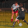 Tribune-Star/Joseph C. Garza<br /> Showdown: Terre Haute South's Nathan Wheeler faces down Washington's Trevor Miller as Miller tries to dribble around Wheeler but to no avail during the Braves' 2-0 loss Wednesday at the North soccer regional.