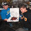 Tribune-Star/Joseph C. Garza<br /> Fundraiser food: Alpha Tau Omega members Seth Eckstein of Jasper and Dustin Harper of Boonville grill hot-dogs for the fraternity's Coats for Kids charity fundraiser Wednesday near the Cunningham Memorial Library on the Indiana State campus.