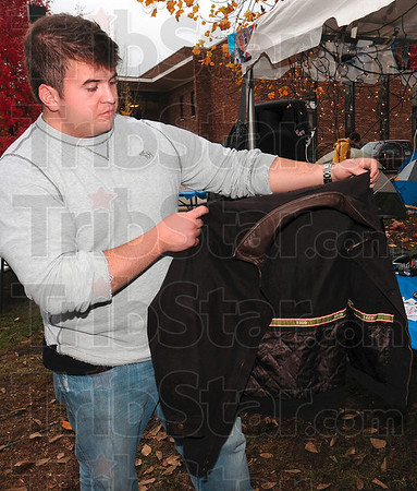 Tribune-Star/Joseph C. Garza<br /> So the little ones can stay warm: Indiana State University Alpha Tau Omega member Nick Renick of Frankfort displays one of the coats donated to the fraternity's Coats for Kids charity fundraiser Wednesday on the Indiana State campus.