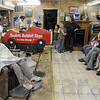 Freebee: Kids wait their turn for a free haircut Monday afternoon at Stadler's Barber Shop. The local business is providing a free haircut for any student in the 8th grade or below. They also provided hotdogs and soft drinks for the kids and their families.
