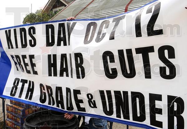Sign detail: Sign at Stadler's Barbershop.