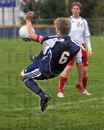 """Wheel kick: North's #6, Benjamin Ramseier attempts a """"wheel kick"""" during sectional action against South Monday evening."""